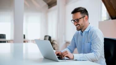 Happy guy on laptop