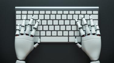 Robotic hands on keyboard