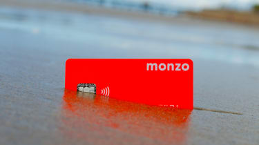 Monzo card in the sand