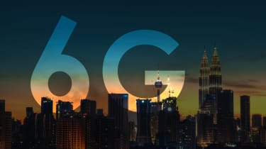6G logo displayed behind the Kuala Lumpur city skyline at dusk