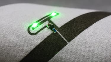 Powercast's Liquid X conductive ink in close up with two green LEDs showing