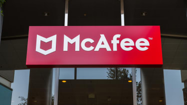 The McAfee company logo hung above the entrance to company offices