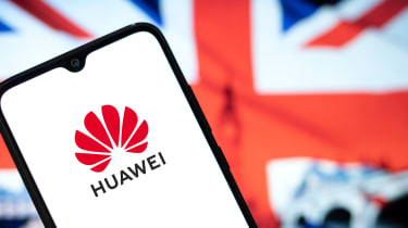 Smart phone displaying Huawei logo on screen with UK flag in the background