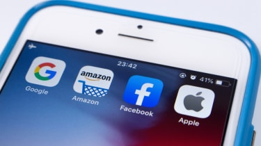 A smartphone with apps for Amazon, Google, Apple and Facebook