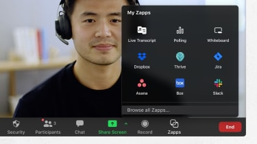 A smiling young man using Zoom's new apps while on a video call