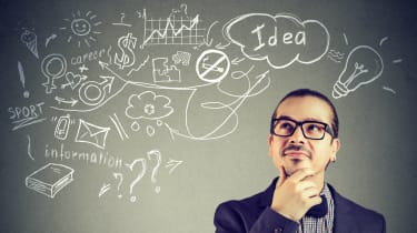 Image of a man thinking in front of a board filled with abstract ideas