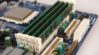 A close-up shot of RAM installed on a socket of a motherboard