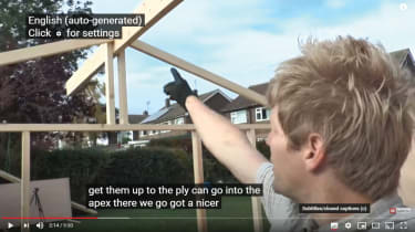 A screenshot of a YouTube video displaying auto subtitles