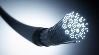 A black fibre optic cable with glowing white tips