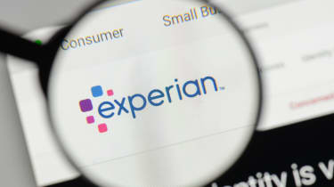 A magnifying glass held over the Experian logo as seen on the company's website