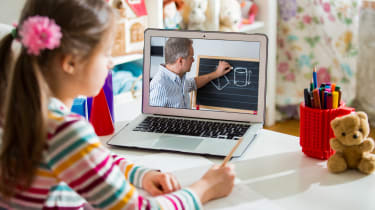 Young girl learning remotely