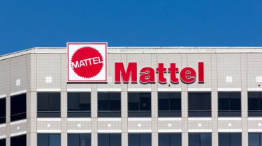 The facade of Mattel's corporate headquarters building in El Segundo, California, with a clear blue sky in the background