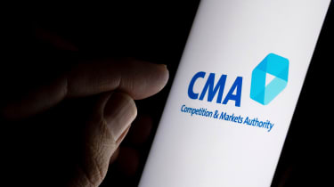 A finger pointing at the Competition and Markets Authority logo on a smartphone