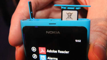 The Lumia 800's micro SIM slot is hidden beneath a flip up cover that's fiddly to pry open.
