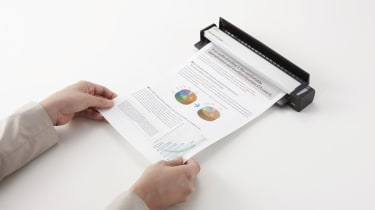 The Fujitsu ScanSnap S1100 being fed paper