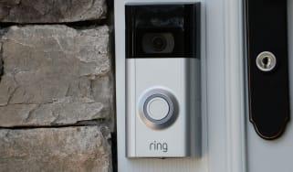 Ring doorbell camera mounted on a door frame