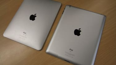 The iPad 2 (right) has a flatter back than the subtly convex rear of the original (left)