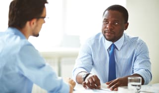 Businessmen giving and receiving advice