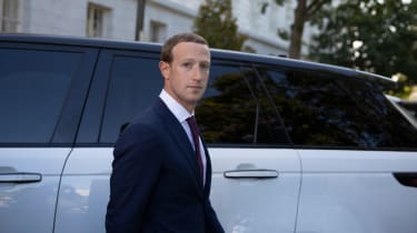 Zuckerberg in front of car