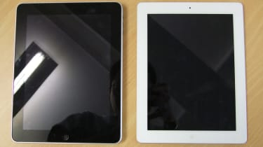 A white Apple iPad 2 side-by-side with its predecessor