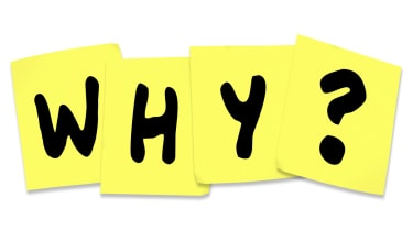 The word 'why' on post-it notes