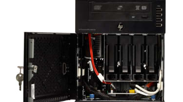 The HP ProLiant MicroServer N36L with its disk trays visible