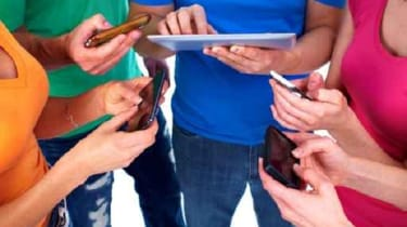 Kids using tablets and smartphones