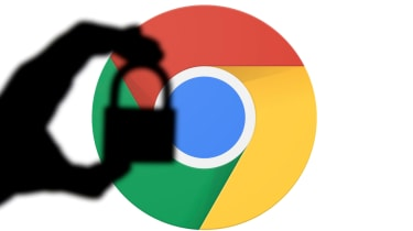 Silhouette of a hand holding a padlock infront of the google chrome logo