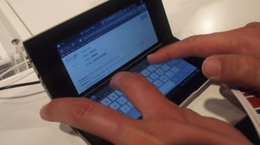 Typing on the Tablet P's bottom screen as if it were a very small laptop.