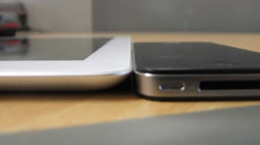 The iPad 2 (left) is ever so slightly thinner than the iPhone 4