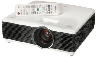 The Samsung F10M projector and its remote control
