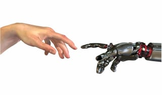 Robotic hand touching human hand