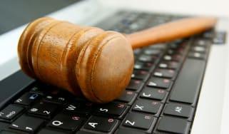 Legal hammer on keyboard