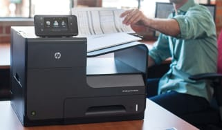 Somebody using a printer in an office