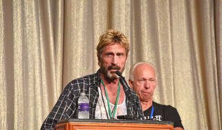 John McAfee speaking at an event