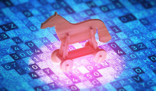 Toy horse on a digital screen to symbolise the attack of the Trojan virus