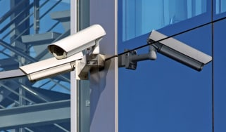 Security cameras on the side of a building