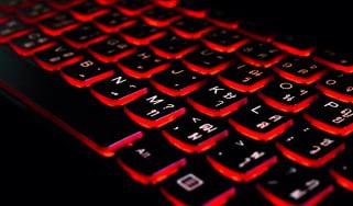 Keyboard with red-glowing keys