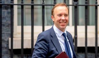 Health Secretary Matt Hancock smiling while walking