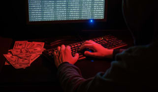 Cyber criminal extorting people at their terminal for cash