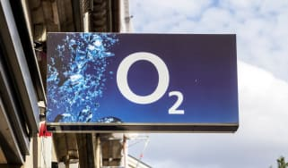 An O2 shop sign with an overcast sky in the background