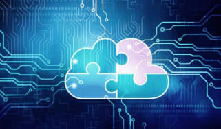 An image of a blue cloud made up of jigsaw parts to illustrate hybrid cloud
