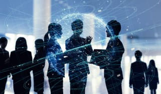 Silhouettes of a team of office workers with a blue technology overlay to represent the future