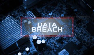 Data Breach overlaying a circuitboard
