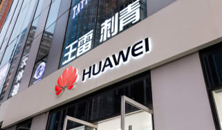Huawei logo displayed on a shopfront