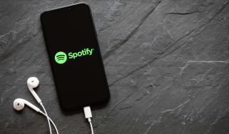 Spotify logo appearing on an Apple iPhone