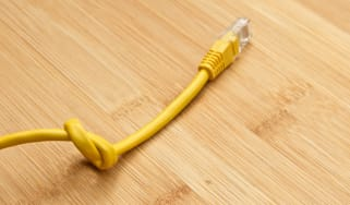 A knotted ethernet cable representing the net neutrality debate