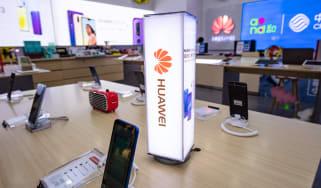Huawei smartphones on display in a Shanghai retail store