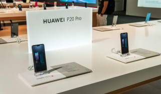 A Huawei smartphone on sale inside a store
