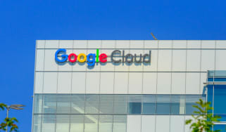 The facade of Google Cloud headquarters against a bright blue sky